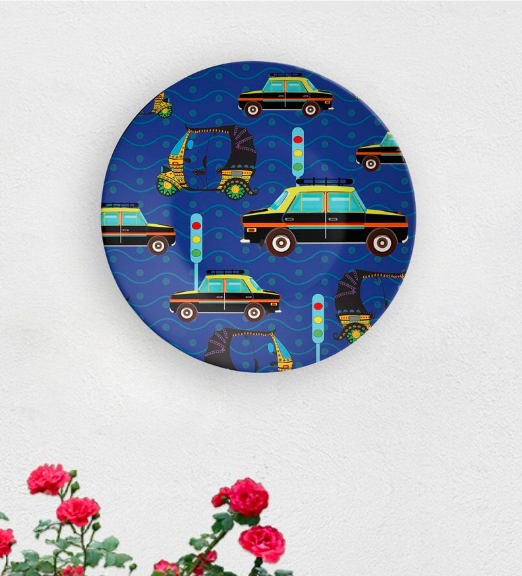 "An ode to Maximum City's iconic kaali peeli, the 8-inch, ceramic <a href=""https://fave.co/2q3O879"" rel=""nofollow noopener"" target=""_blank"" data-ylk=""slk:Mumbai Roads wall plate by Quirk India"" class=""link rapid-noclick-resp""><strong>Mumbai Roads wall plate by Quirk India</strong></a>. <em>Rs.749 on offer. </em><a href=""https://fave.co/2q3O879"" rel=""nofollow noopener"" target=""_blank"" data-ylk=""slk:Flash sale!"" class=""link rapid-noclick-resp""><strong>Flash sale!</strong></a>"