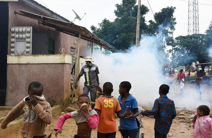 "<span class=""caption"">Children run as an agent of the National Institute of Public Hygiene carries out fumigation in the Anyama district of Abidjan,Ivory Coast. </span> <span class=""attribution""><a class=""link rapid-noclick-resp"" href=""https://www.gettyimages.com/detail/news-photo/children-run-as-an-agent-of-the-national-institute-of-news-photo/970881256?adppopup=true"" rel=""nofollow noopener"" target=""_blank"" data-ylk=""slk:SIA KAMBOU/AFP via Getty Images"">SIA KAMBOU/AFP via Getty Images</a></span>"