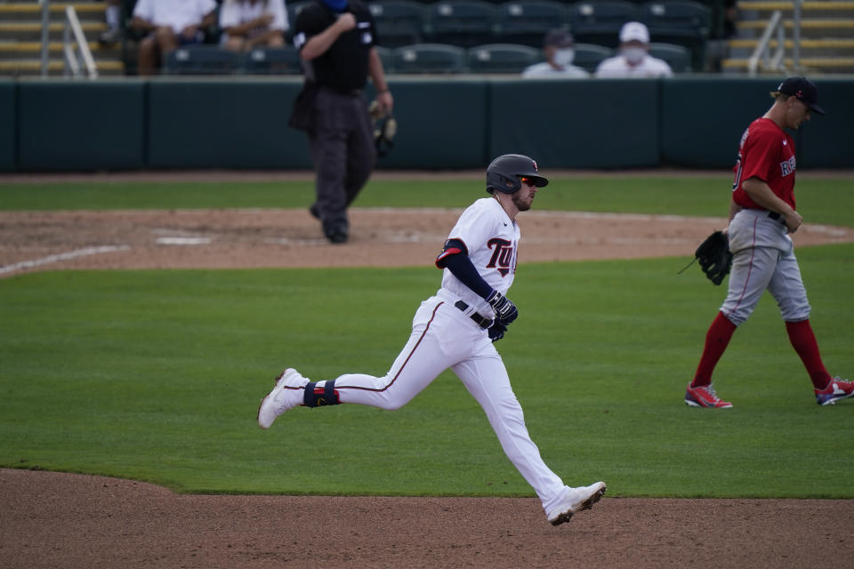 Minnesota Twins' JT Riddle runs to second base during a spring training baseball game int the fourth inning against the Boston Red Sox on Sunday, Feb. 28, 2021, in Fort Myers, Fla. (AP Photo/Brynn Anderson)
