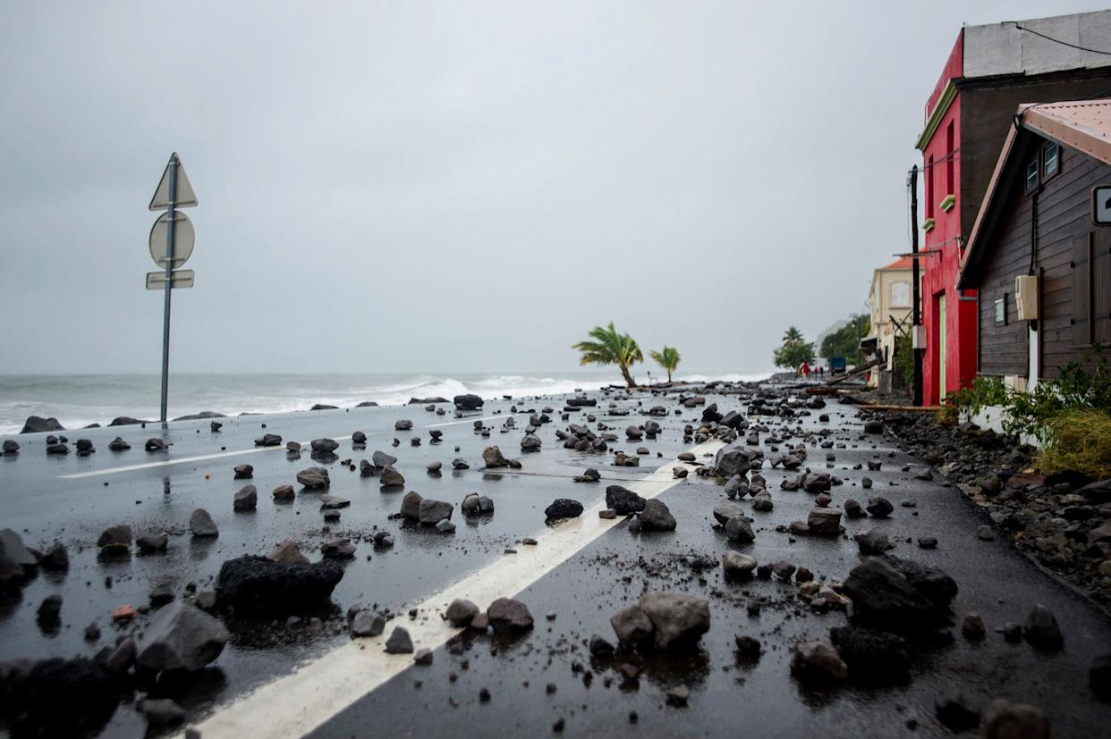 Strong waves driven by Hurricane Maria swept rocks onto a road in Le Carbet, Martinique, seen on Sept. 19, 2017.