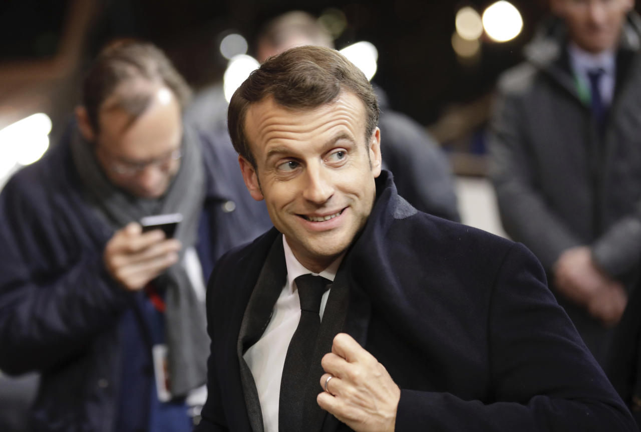 French President Emmanuel Macron leaves an EU summit in Brussels, Friday, March 22, 2019. Worn down by three years of indecision in London, EU leaders on Thursday were grudgingly leaning toward giving the U.K. more time to ease itself out of the bloc. (AP Photo/Olivier Matthys)