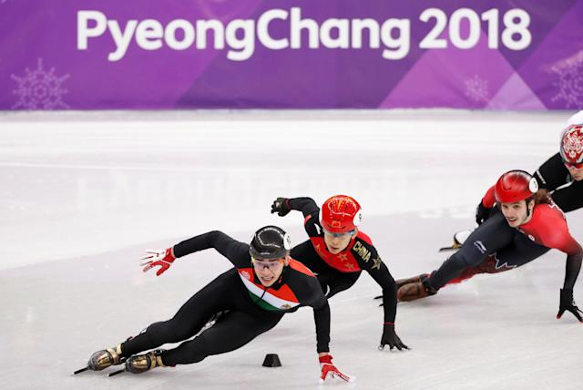 Short Track Speed Skating Events - Pyeongchang 2018 Winter Olympics - Men's 5000m Relay Final - Gangneung Ice Arena - Gangneung, South Korea - February 22, 2018 - Sandor Liu Shaolin of Hungary leads Han Tianyu of China, and Samuel Girard of Canada. TPX IMAGES OF THE DAY