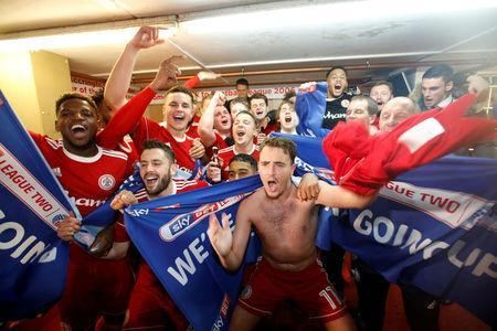 FILE PHOTO: April 17, 2018. Accrington Stanley players celebrate in the dressing room after winning promotion to League One Action Images/Carl Recine/File Photo