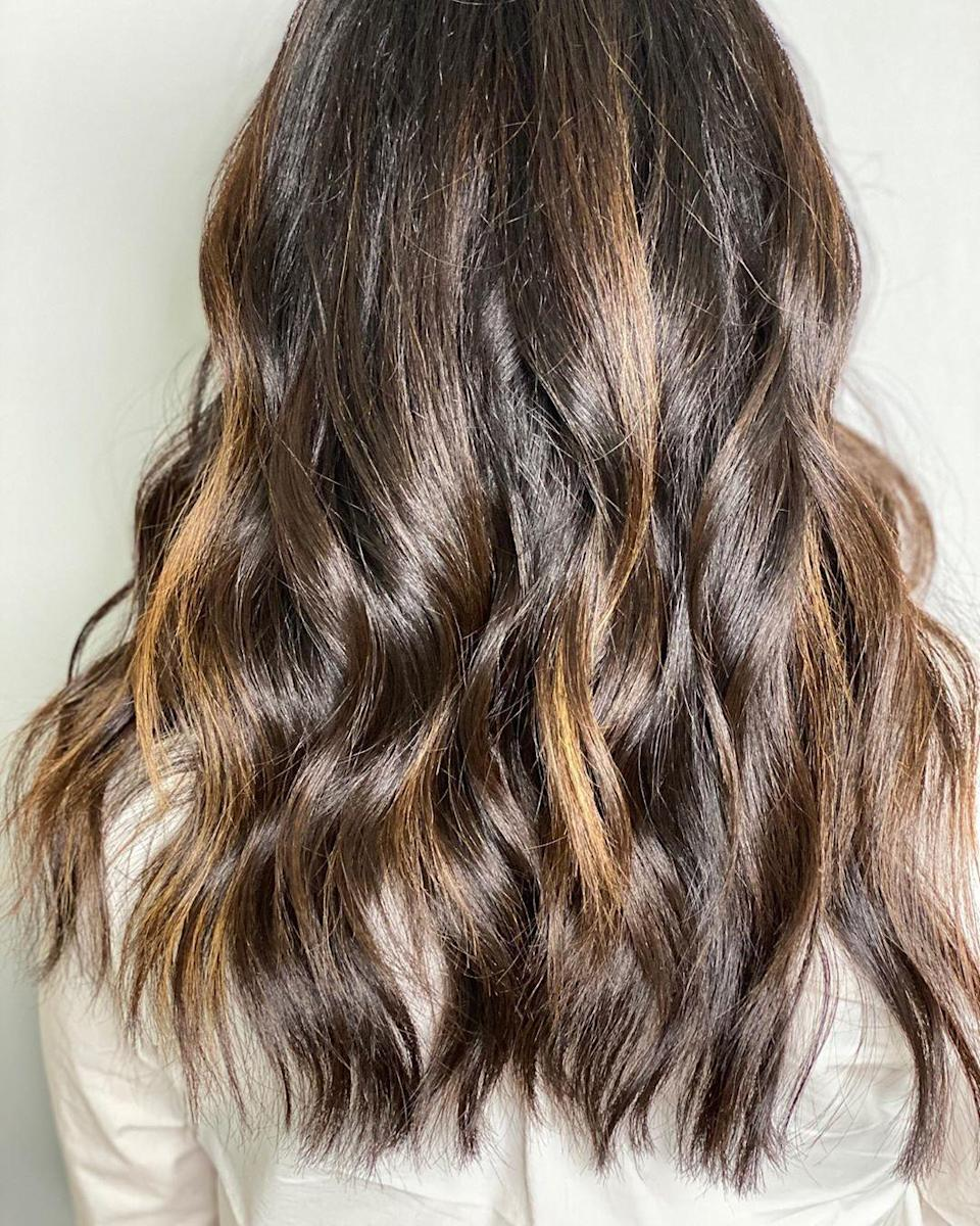 """This falls under the warmer brunette family,"" says Schaudt. ""This look is adding golden undertones that will create a healthy appearance and reflect tons of new shine. """