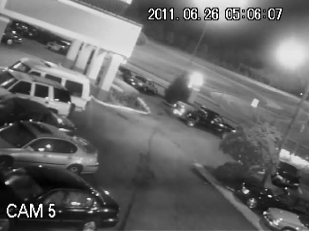 In this June 26, 2011 frame grab from a security video, a pickup truck can be seen exiting a Jackson, Miss., parking lot. Its driver, Deryl Dedmon, a white teen, is accused of having driven out of the parking lot and having run down James Craig Anderson, a 49-year-old black man, on the Jackson street. The incident, stoked in part by security camera footage showing Anderson being run over, is causing people across the country to sound off on social media pages created for and against the defendants. (AP Photo)