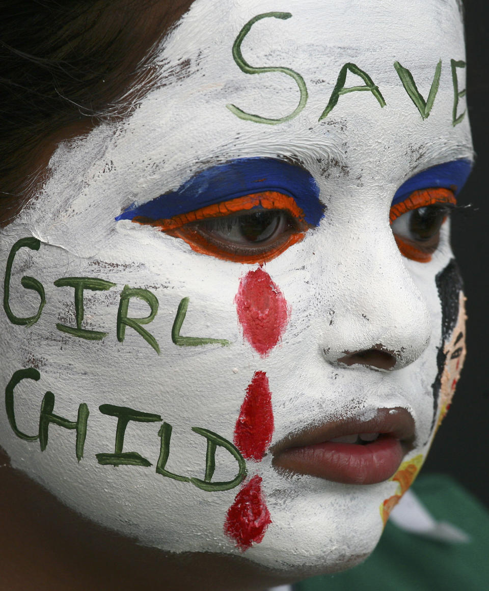 A girl with her face painted with an awareness message on female foeticide participates in a face-painting competition in the northern Indian city of Chandigarh August 1, 2009. REUTERS/Ajay Verma (INDIA SOCIETY IMAGES OF THE DAY) - GM1E582071X01