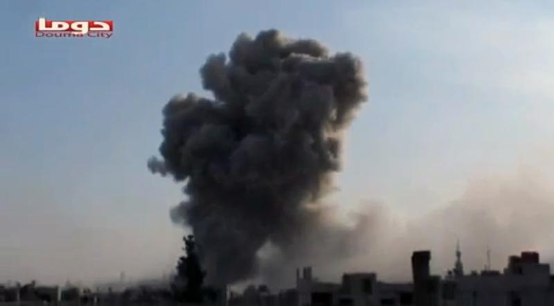 This image taken from video obtained from Shaam News Network, which has been authenticated based on its contents and other AP reporting, shows smoke rising from a residential area of the city during bombing from military warplanes, in Douma, Syria, Friday, Nov. 9, 2012. (AP Photo/Shaam News Network via AP video)