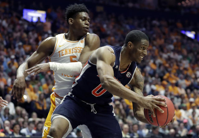 Auburn's Horace Spencer (0) holds the ball as Tennessee's Admiral Schofield defends in the second half of the NCAA college basketball Southeastern Conference championship game Sunday, March 17, 2019, in Nashville, Tenn. (AP Photo/Mark Humphrey)