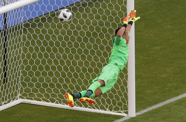 Costa Rica goalkeeper Keylor Navas losses a goal scored by Serbia's Aleksandar Kolarov during the group E match between Costa Rica and Serbia at the 2018 soccer World Cup in the Samara Arena in Samara, Russia, Sunday, June 17, 2018. (AP Photo/Vadim Ghirda)