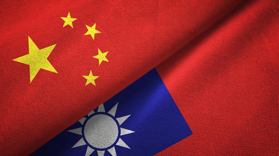 Taiwan and China flags together textile cloth, fabric texture