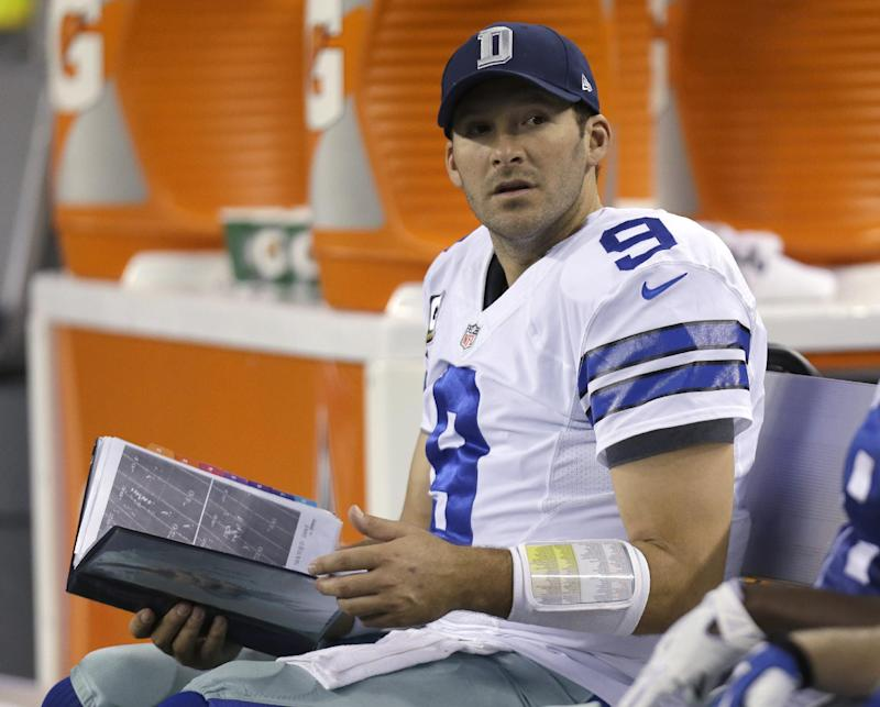 FILE - In this Dec. 15, 2013, file photo, Dallas Cowboys quarterback Tony Romo (9) sits on the bench with a book of play printouts during the second half of an NFL football game against the Green Bay Packers in Arlington, Texas. NFL teams used to take Polaroid pictures of plays from atop the stadium during games then send them down to the field on a rope. Technology improved so that an automated camera could deliver the images to a printer on the sideline, creating that familiar sight of a quarterback staring at a sheet of paper to figure out what went wrong on an interception. That was still the case last season, when fans in the stands could watch highlights on their smartphones, but players and coaches were flipping through three-ring binders of black-and-white photos. (AP Photo/Tim Sharp, File)