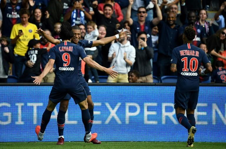 Kylian Mbappe is congratulated by Edinson Cavani, while Neymar joins in the goal celebrations in PSG's 3-1 win over Angers