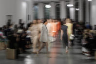 Models wear creations as part of the Sportmax 2021 women's spring-summer ready-to-wear collection during the Milan's fashion week in Milan, Italy, Friday, Sept. 25, 2020. (AP Photo/Luca Bruno)