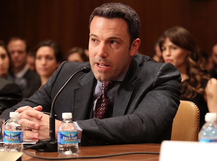 """Actor, filmmaker and founder of the Eastern Congo Initiative Ben Affleck testifies before a Senate Appropriations Subcommittee on State, Foreign Operations, and Related Programs hearing on """"Diplomacy, Development, and National Security"""" on March 26, 2015. His wife, Jennifer Garner, looks on."""