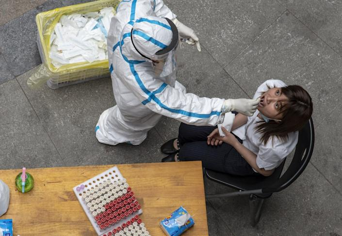"""A resident of Wuhan, China, is tested for the coronavirus. The new infections reported May 10, 2020, were the first since early April. <span class=""""copyright"""">(For The Times)</span>"""