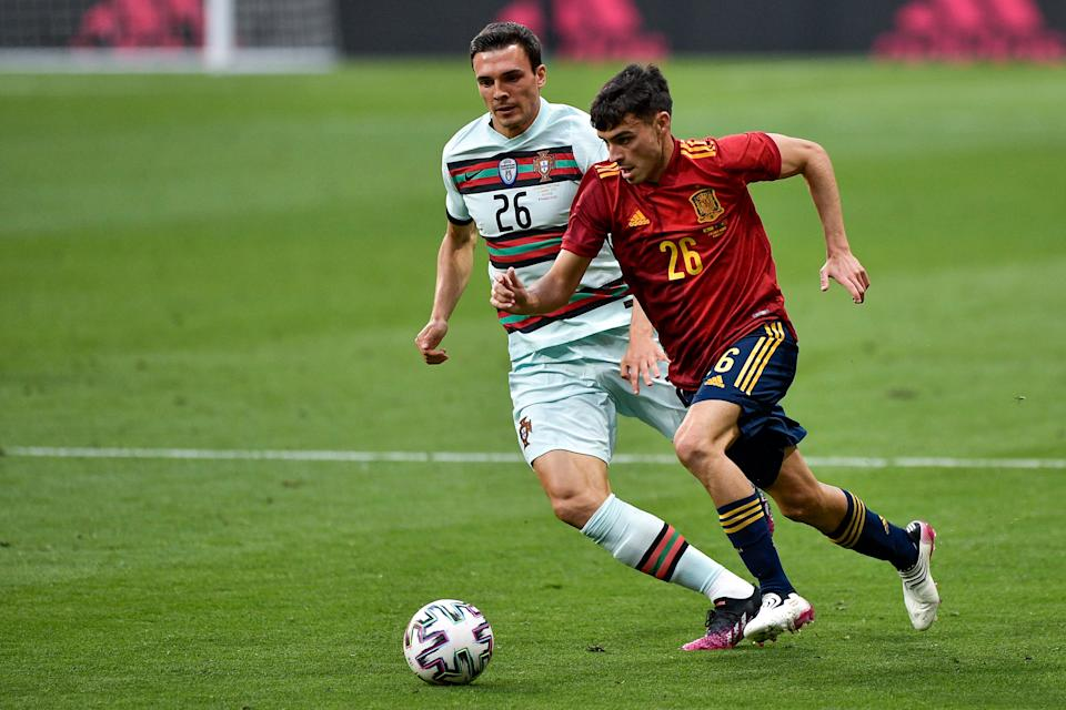 MADRID, SPAIN - JUNE 4: Pedri of Spain and Joao Palhinha of Portugal during the International Friendly match between Spain and Portugal at Wanda Metropolitano on June 4, 2021 in Madrid, Spain (Photo by Pablo Morano/BSR Agency/Getty Images)