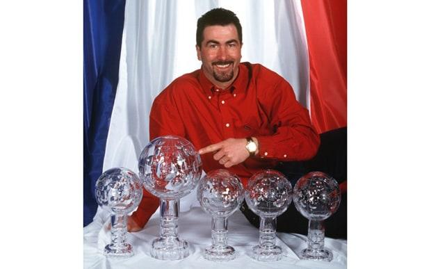 Luc Alphand posing with his ski trophies