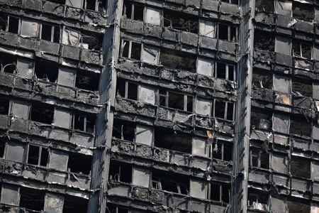 The burnt out remains of the Grenfell Tower are seen in North Kensington, London