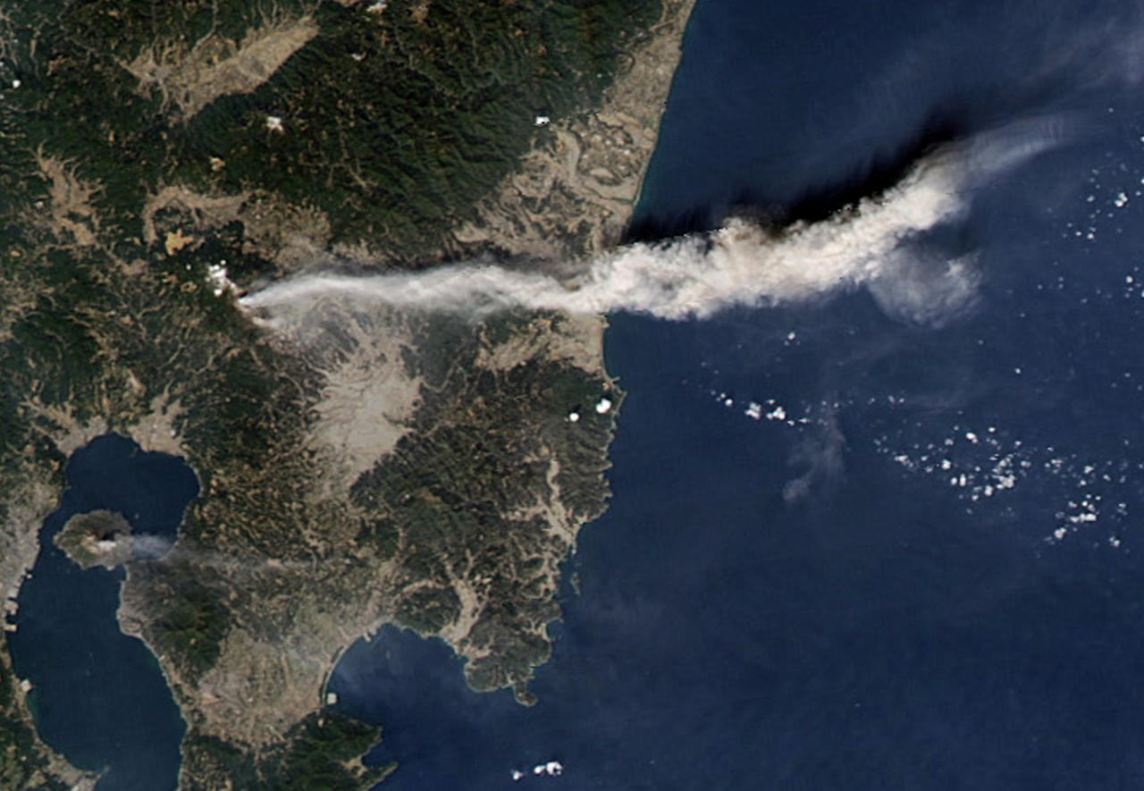 Volcanic ashes from Shinmoedake peak, located between Miyazaki and Kagoshima prefectures, is seen in southern Japan, in this NASA satellite image taken and released February 3, 2011. More than 1,000 people in southern Japan have been urged to evacuate as the volcano picked up its activities, spewing ashes and small rocks into the air and disrupting airline operations, a municipal official said on Monday. Image taken February 3, 2011.  (REUTERS/NASA/Handout)