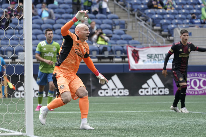 Atlanta United goalkeeper Brad Guzan gestures from the goal during the second half of an MLS soccer match against the Seattle Sounders, Sunday, May 23, 2021, in Seattle. (AP Photo/Ted S. Warren)