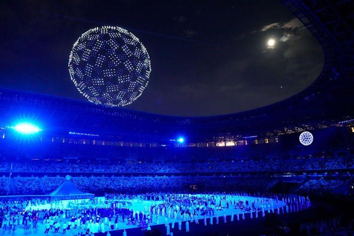<p>A drone display flew over the Olympic Stadium. </p>