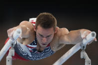 Samuel Mikulak, of the United States, performs on the parallel bars during the artistic men's team final at the 2020 Summer Olympics, Monday, July 26, 2021, in Tokyo. (AP Photo/Natacha Pisarenko)