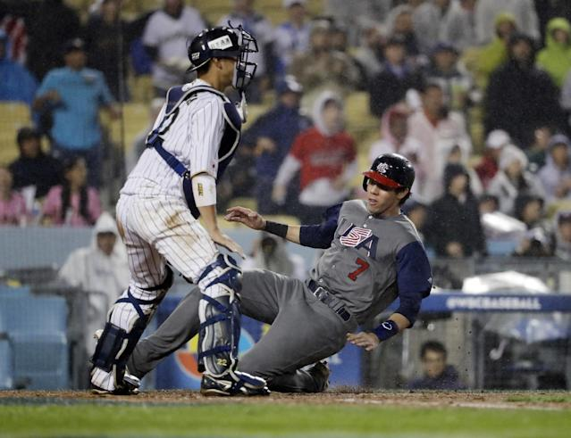 <p>United States' Christian Yelich scores past Japan catcher Seiji Kobayashi during the fourth inning of a semifinal in the World Baseball Classic in Los Angeles, Tuesday, March 21, 2017. (AP Photo/Chris Carlson) </p>