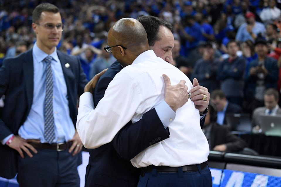 COLUMBIA, SC - MARCH 24: Head coach Mike Krzyzewski of the Duke Blue Devils and head coach Johnny Dawkins of the UCF Knights embrace after their game in the second round of the 2019 NCAA Men's Basketball Tournament held at Colonial Life Arena on March 24, 2019 in Columbia, South Carolina. (Photo by Grant Halverson/NCAA Photos via Getty Images)
