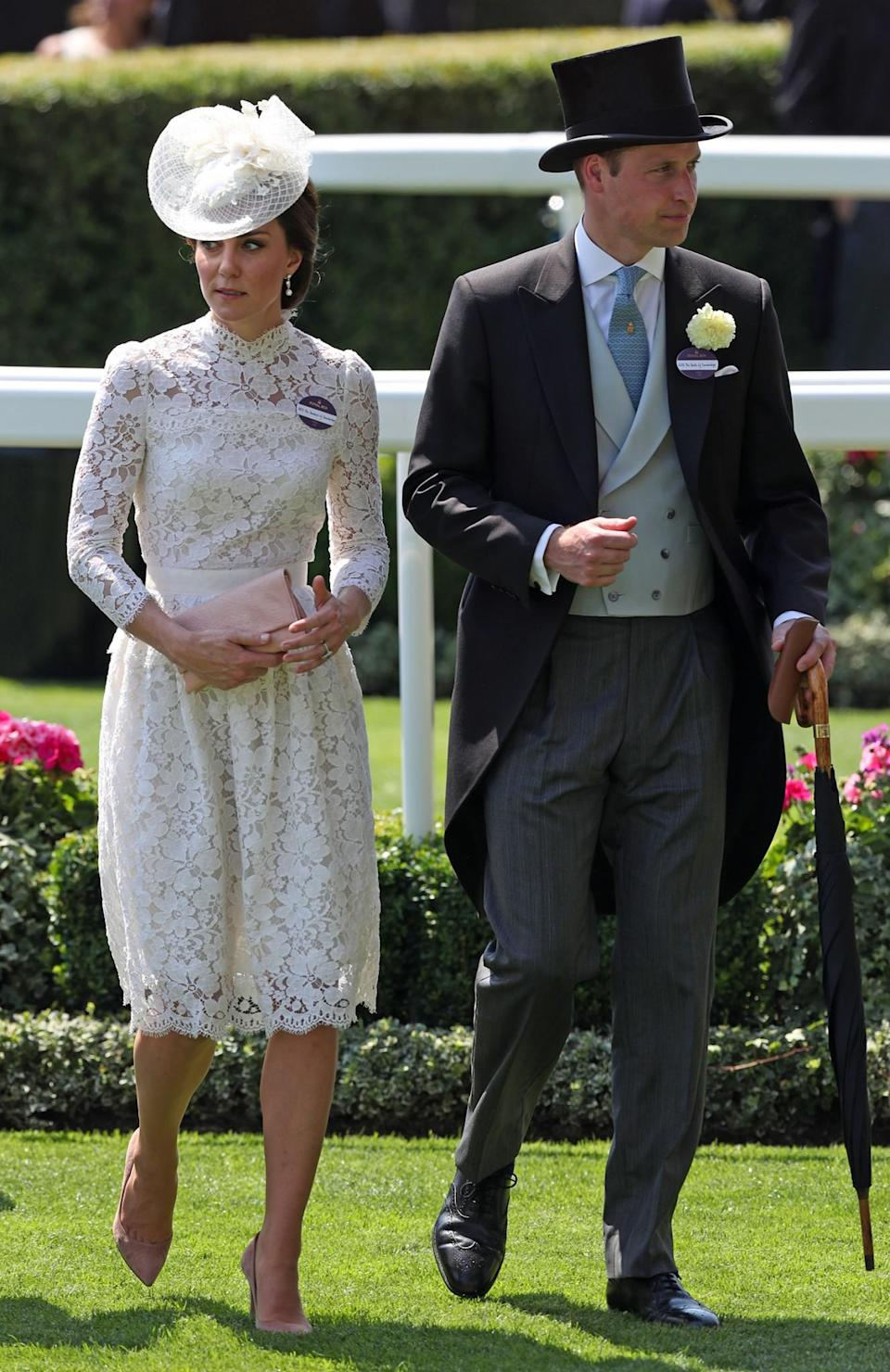 <p>Kate looked lovely in a lace, midi number by Alexander McQueen. The dress featured a high neck and was very similar to the Dolce & Gabanna outfit the mum-of-two wore in 2016 at the races. She wore her favourite Gianvito Rossi suede heels in the 'praline' colourway on her feet and carried a new clutch. Prince William opted to wear a tri-tone outfit, including a black jacket, grey trousers and light grey waist coat.<br><em>[Photo: PA]</em> </p>