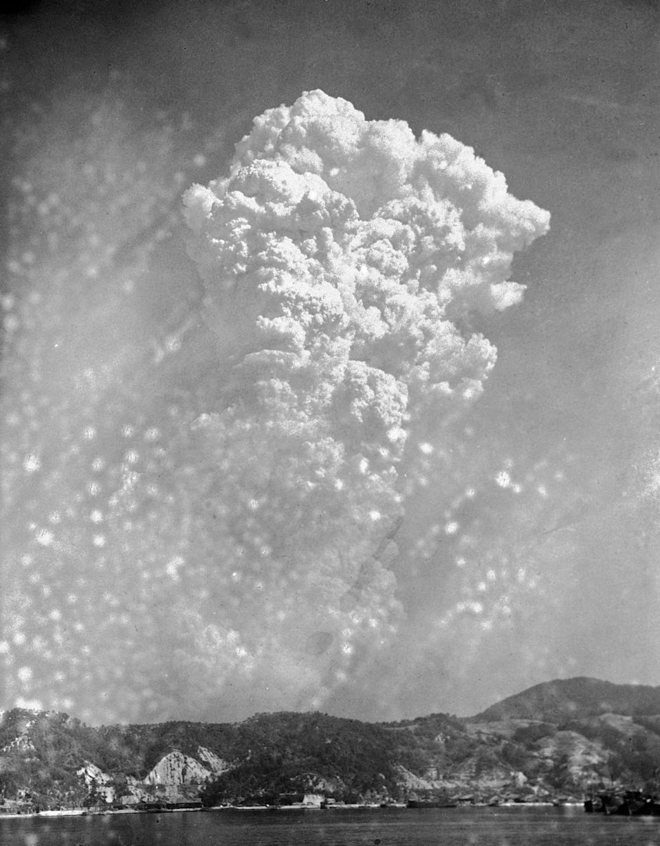 Smoke rises around 20,000 feet above Hiroshima, Japan, after the first atomic bomb was dropped on Aug. 6, 1945.