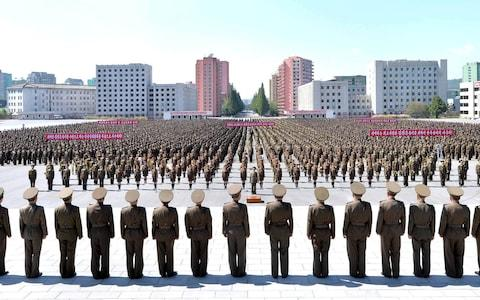 Members of the People's Security Council take part an anti-U.S. rally, in this September 23, 2017 photo released by North Korea's Korean Central News Agency (KCNA) in Pyongyang. - Credit: REUTERS