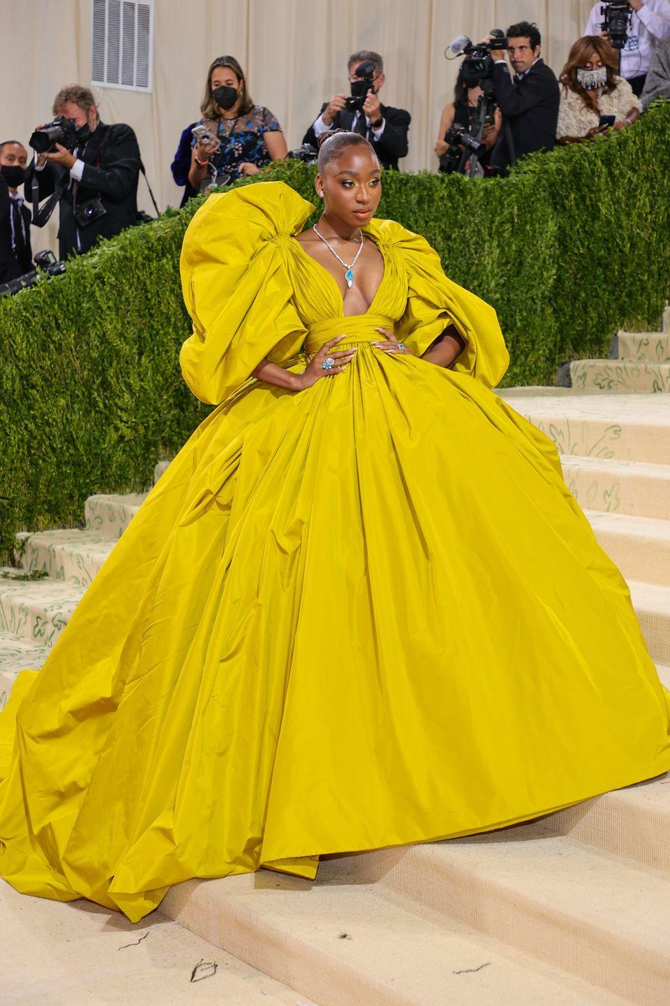 <p>Normani had a picture-perfect moment in a Valentino couture gown for the 2021 Met Gala. The dress featured an enormous skirt, a dramatic train and huge sleeves, all of which made for big, head-turning fashion, which is what this event is all about.</p>