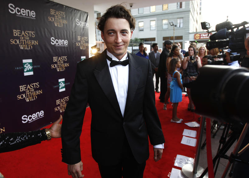 """Benh Zeitlin, director and co-writer of the movie """"Beasts Of The Southern Wild,"""" arrives at the premiere at the Joy Theater in New Orleans, Monday, June 25, 2012. (AP Photo/Gerald Herbert)"""