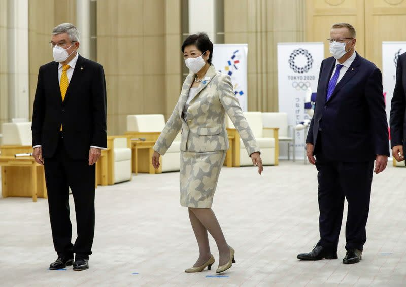 Thomas Bach, President of the IOC, and chairman of the Tokyo 2020 Olympic Games coordination committee John Coates are greeted by Tokyo Governor Yuriko Koike at the start of their talks in Tokyo
