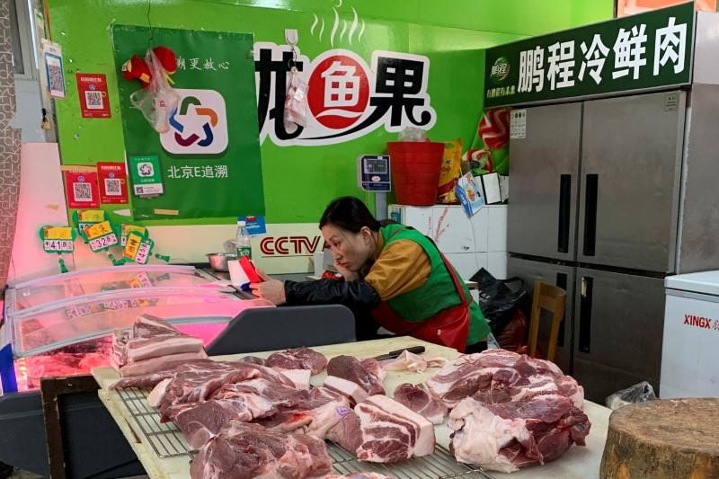 China's November pork imports surge 150% on year ago after pig disease