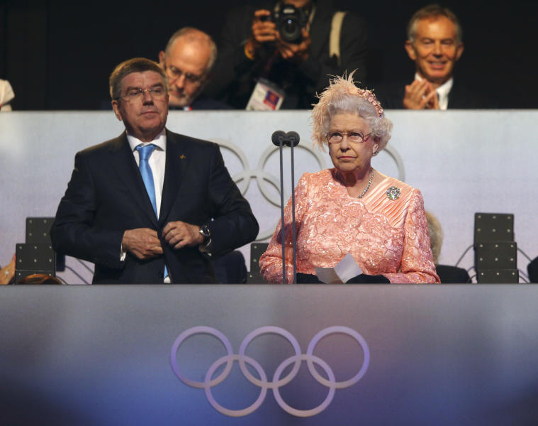 Britain's Queen Elizabeth II, right, declares the games open alongside International Olympic Committee Vice President Thomas Bach during the Opening Ceremony at the 2012 Summer Olympics, Saturday, July 28, 2012, in London. (AP Photo/Cameron Spencer, Pool)