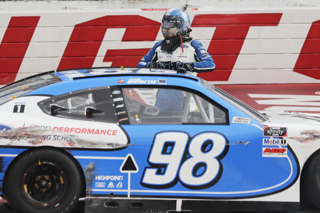 Chase Briscoe gets out of his car after winning the NASCAR Xfinity series auto race Thursday, May 21, 2020, in Darlington, S.C. (AP Photo/Brynn Anderson)