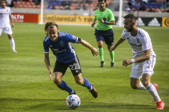Real Salt Lake forward Justin Meram (9) and San Jose Earthquakes defender Tommy Thompson (22) chase the ball during an MLS soccer match Friday, May 7, 2021, in Sandy, Utah. (Annie Barker/The Deseret News via AP)
