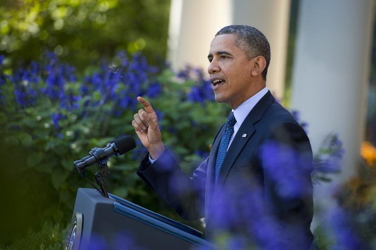 US President Barack Obama speaks about the Affordable Care Act in the Rose Garden of the White House in Washington, DC, October 21, 2013