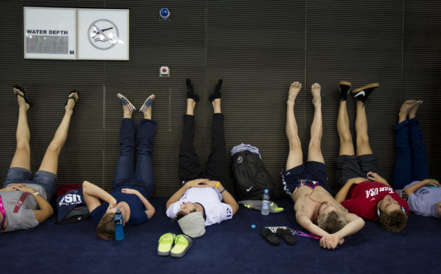Paralympics athletes from the United States rest after their training at the swimming pool of the Aquatic Center ahead of the 2012 Paralympics Olympics, London, Tuesday, Aug. 28, 2012. The opening ceremony for the Paralympic Games will be held at London's Olympic Park on Wednesday Aug. 29. (AP Photo/Emilio Morenatti)