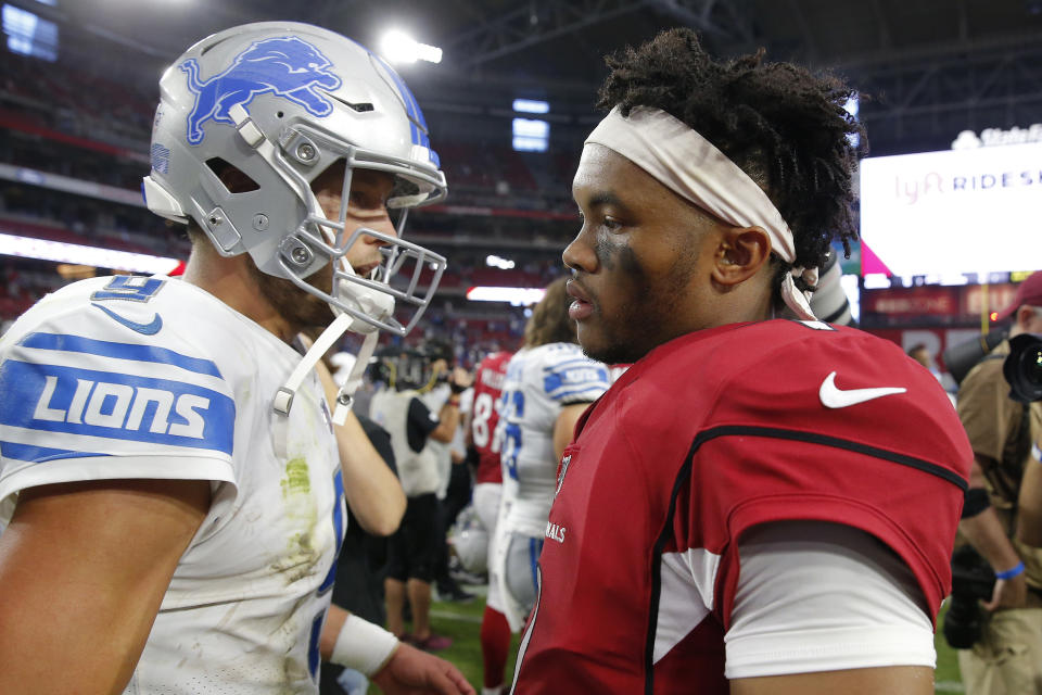 Arizona Cardinals quarterback Kyler Murray, right, greets Detroit Lions quarterback Matthew Stafford after an NFL football game against the Detroit Lions, Sunday, Sept. 8, 2019, in Glendale, Ariz. The Lions and Cardinals played to a 27-27 tie on overtime. (AP Photo/Rick Scuteri)
