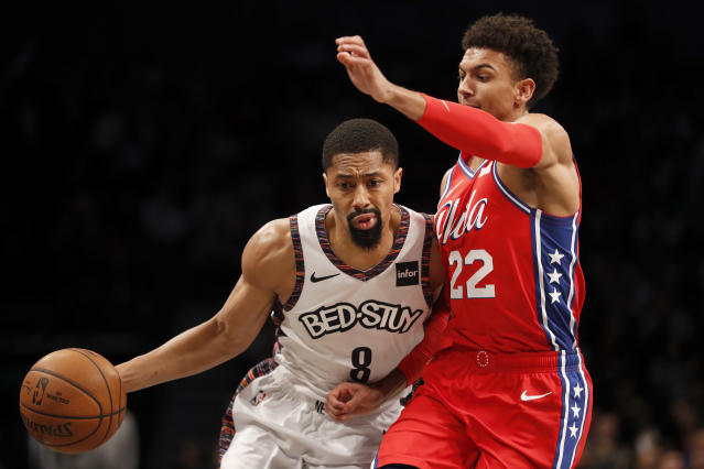 Brooklyn Nets guard Spencer Dinwiddie (8) drives to the basket as Philadelphia 76ers guard Matisse Thybulle (22) defends against him during the second quarter of an NBA basketball game at Barclays Center, Sunday, Dec. 15, 2019, in New York. (AP Photo/Michael Owens)