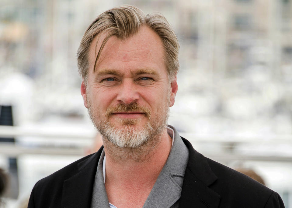 """FILE - In this May 12, 2018, file photo, director Christopher Nolan poses during a photo call at the 71st international film festival in Cannes, southern France. Warner Bros. announced late Thursday, June 25, that it is delaying the release of Nolan's sci-fi thriller """"Tenet"""" from July 31 until Aug. 12, a date the studio says will give it more flexibility to get the film in theaters despite uncertainty caused by a surge in coronavirus cases in certain locales. (Photo by Arthur Mola/Invision/AP, File)"""