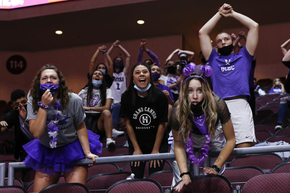 Grand Canyon fans react during the second half of an NCAA college basketball game against California Baptist for the championship of the Western Athletic Conference women's tournament Saturday, March 13, 2021, in Las Vegas. (AP Photo/Chase Stevens)