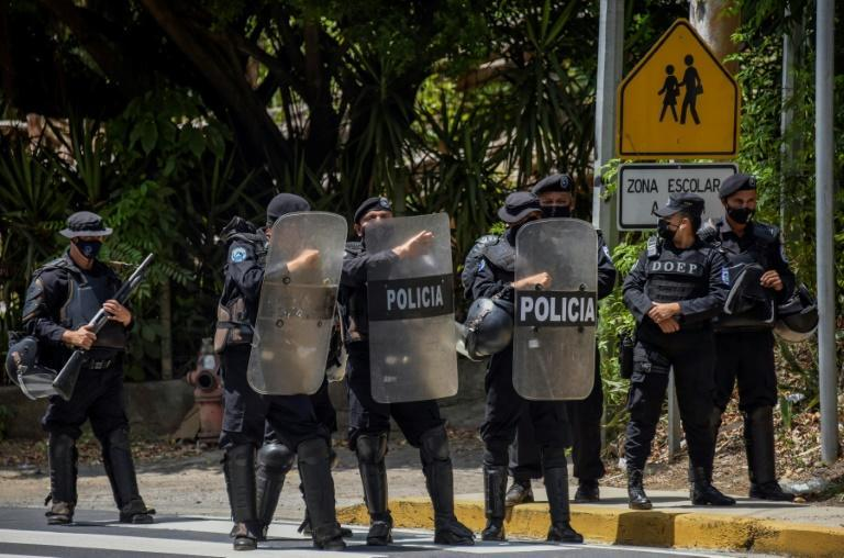 Riot police stand guard outside the house of Nicaraguan opposition leader Cristiana Chamorro