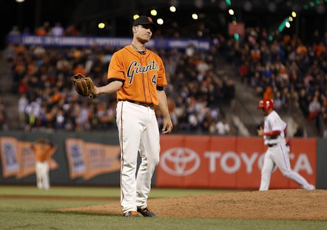 San Francisco Giants pitcher Javier Lopez reacts after hitting Philadelphia Phillies' Chase Utley with a pitch, forcing a run scored because the bases were loaded during the tenth inning of a baseball game, Friday, Aug. 15, 2014, in San Francisco. (AP Photo/Beck Diefenbach)