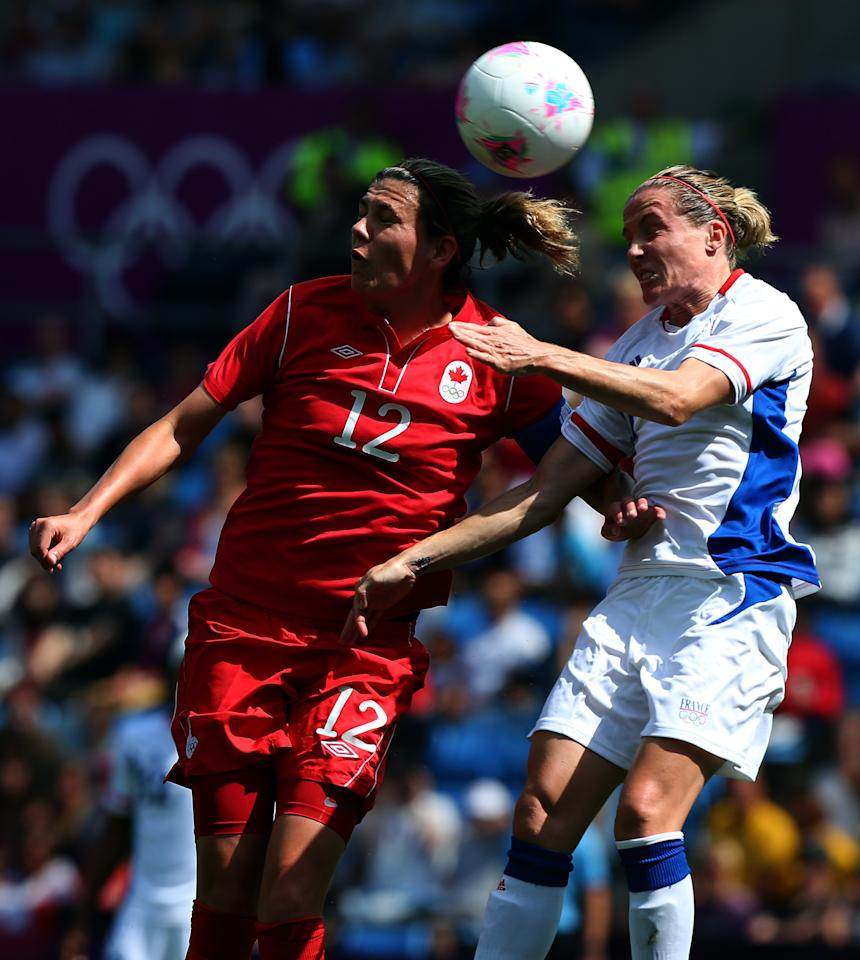 COVENTRY, ENGLAND - AUGUST 09:  Christine Sinclair of Canada battles with Sandrine Soubeyrand of France during the Women's Football Bronze Medal match between Canada and France, on Day 13 of the London 2012 Olympic Games at City of Coventry Stadium on August 9, 2012 in Coventry, England.  (Photo by Stanley Chou/Getty Images)