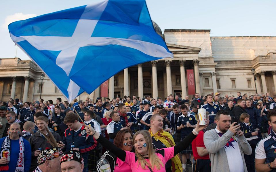 Scotland fans in Trafalgar Square, London, as thousands of football fans descend on the capital for the England v Scotland World Cup qualifier. - Stefan Rousseau