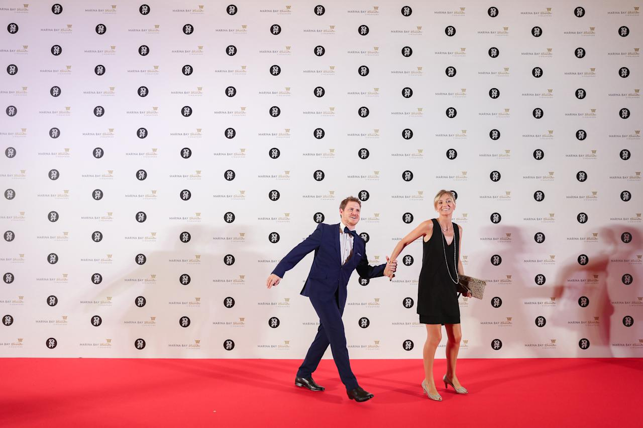<p>A pair of VIP guests hurrying past a photo wall on the red carpet during their attendance at the 28th SGIFF Benefit Dinner at the Marina Bay Sands Expo & Convention Centre. (Photo: Don Wong for Yahoo Lifestyle Singapore) </p>
