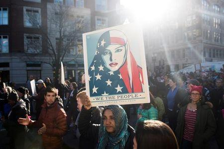 The Boston Women's March for America makes its way down Boylston Street in Boston, Massachusetts, U.S., January 21, 2017.     REUTERS/Sam Goresh